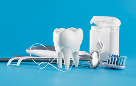 photo of a tooth and dental floss