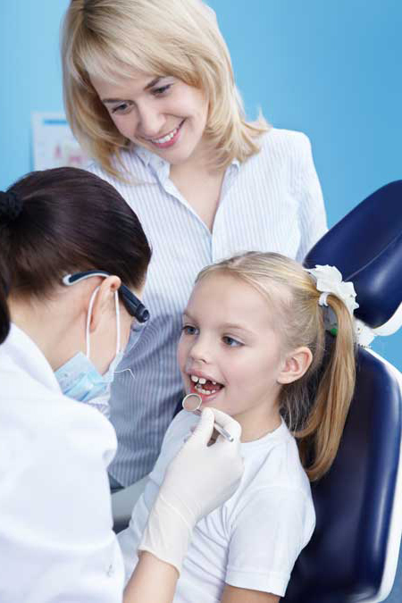 child and mother at the dentist
