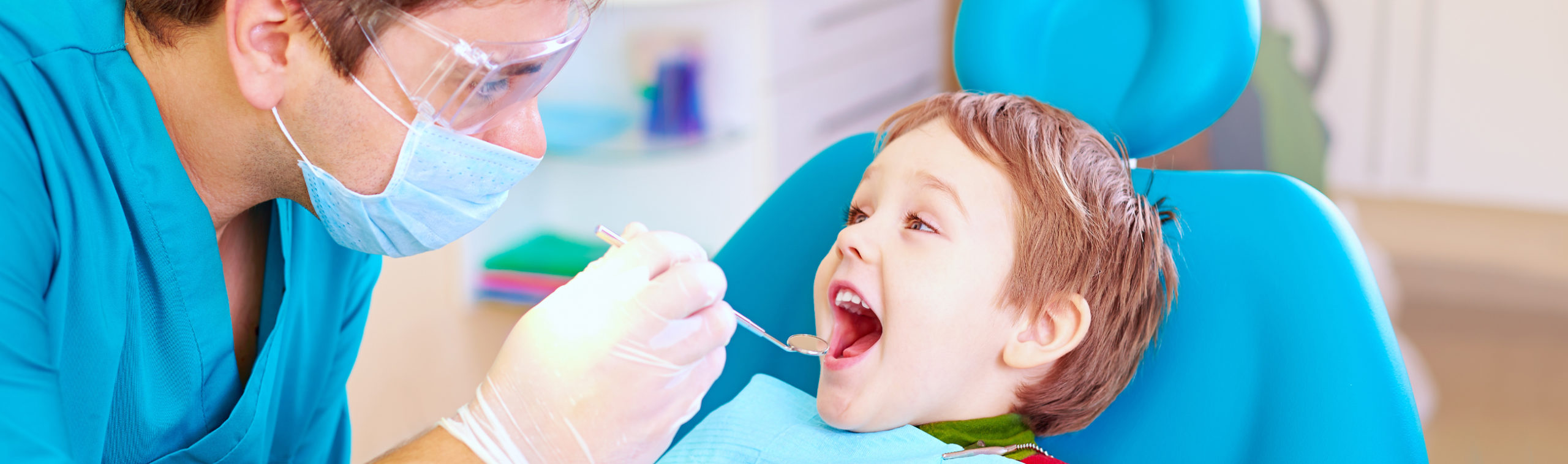 child getting examined by kitchener dentist