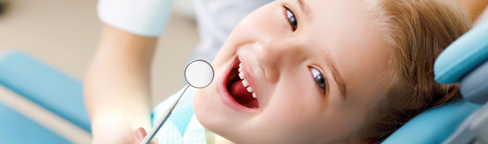 child at a dental exam
