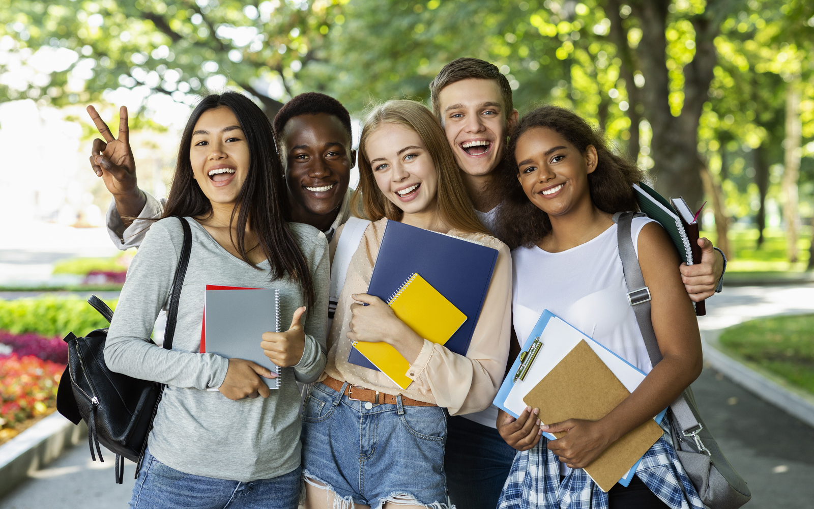 group of teens smiling and laughing