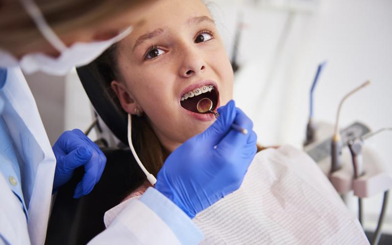 child with dentist